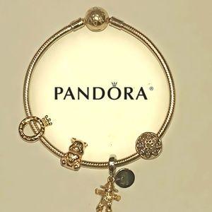 Pandora 18k gold shine bracelet & 4 Pandora charms